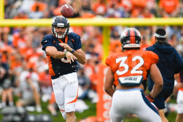 Denver Broncos quarterback Chad Kelly throws to fullback Andy Janovich (32) during training camp on Friday, August 3, 2018.