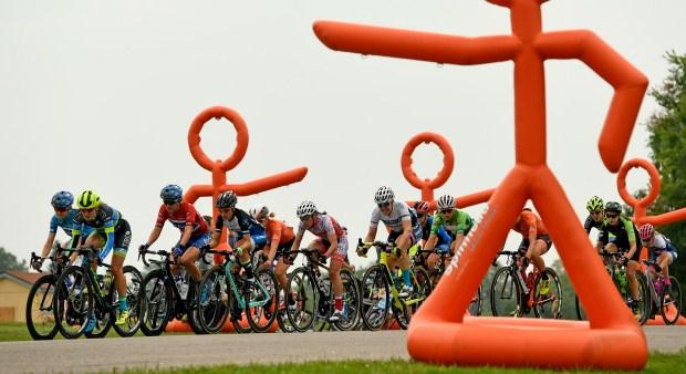 Women racers in the peloton race ...