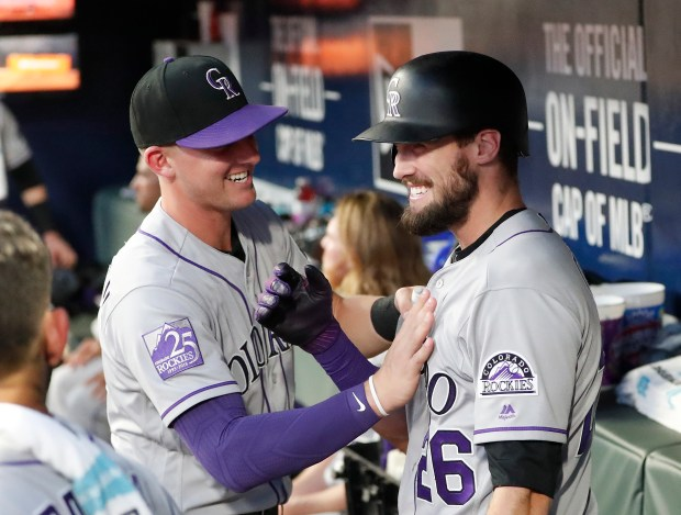 Colorado Rockies' David Dahl, right, celebrates ...