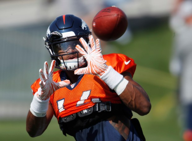 Denver Broncos wide receiver Courtland Sutton takes part in drills at the team's headquarters during an NFL football training camp Saturday, Aug. 4, 2018, in Englewood.