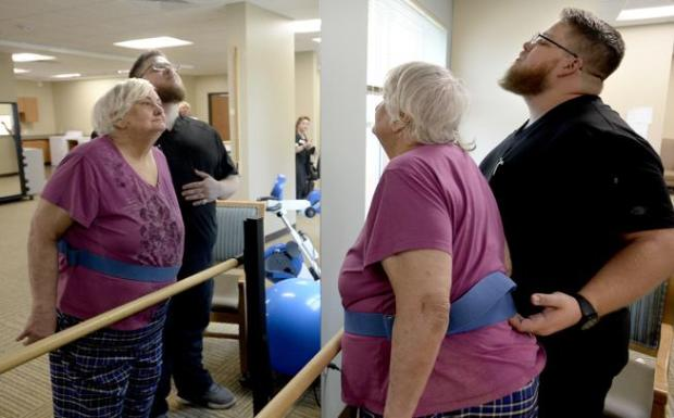 Physical therapist Matt Nape works with Shirley Robba during an Aug. 21 physical therapy session at Flatirons Health and Rehab Center in Louisville.