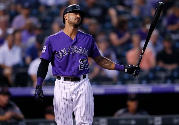 Colorado Rockies' Ian Desmond reacts after ...