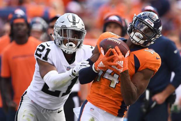 Courtland Sutton (14) of the Denver Broncos makes a catch that is ruled incomplete during the third quarter against the Oakland Raiders at Broncos Stadium at Mile High in Denver on Sunday, Sept. 16, 2018.