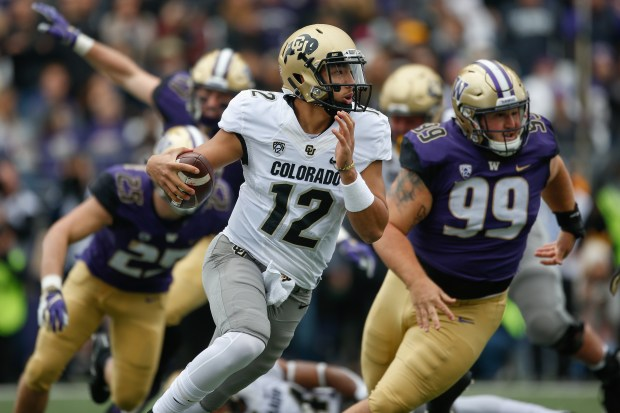 Quarterback Steven Montez of the Colorado Buffaloes rushes against the Washington Huskies at Husky Stadium on Oct. 20, 2018 in Seattle.