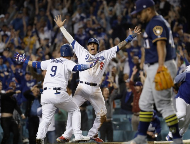 Los Angeles Dodgers' Manny Machado reacts ...