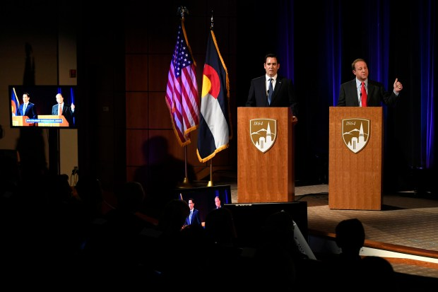 Gubernatorial candidates Republican Walker Stapleton, left, ...