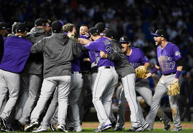 The Colorado Rockies celebrate after defeating ...