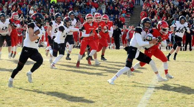 Loveland quarterback Riley Kinney provides a ...