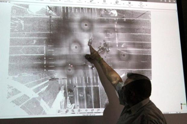 Larimer County Sheriff's Office Cpl. Steve Wicker points to a top-down, 3D rendering Oct. 2 of a crash that took place on U.S. 287 near Berthoud in January. The circular spots are where scanners took readings.