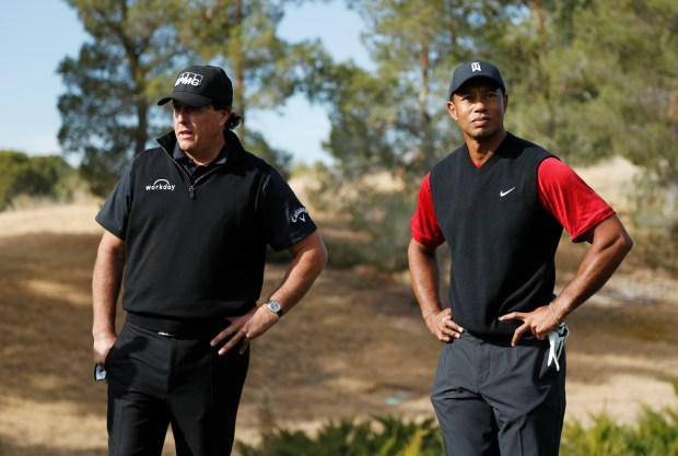 Phil Mickelson, left, and Tiger Woods ...
