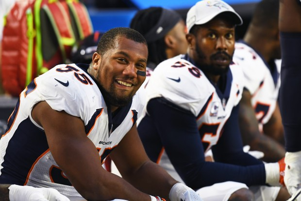 Bradley Chubb (55) of the Denver Broncos smiling on the bench with Von Miller (58) during a strong first half showing against the Arizona Cardinals at State Farm Stadium on Oct. 18, 2018 in Glendale, Ariz.