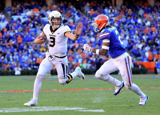 Drew Lock (3) of the Missouri Tigers rushes against Brad Stewart Jr. (2) of the Florida Gators during the game at Ben Hill Griffin Stadium on Nov. 3, 2018 in Gainesville, Fla.