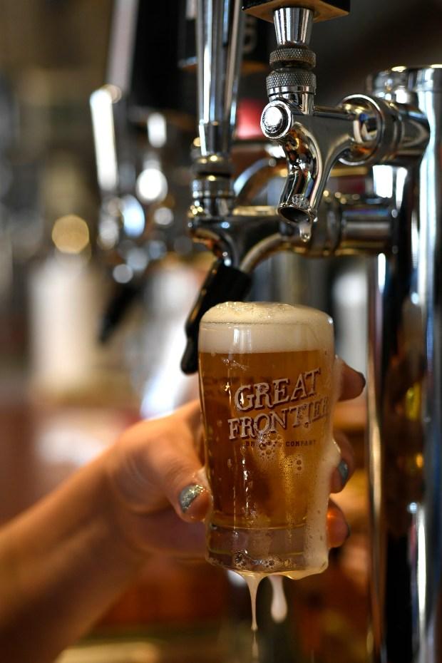 Bartender Devon Cisneros pours a glass ...