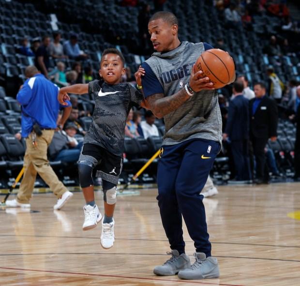 Denver Nuggets guard Isaiah Thomas, right, ...