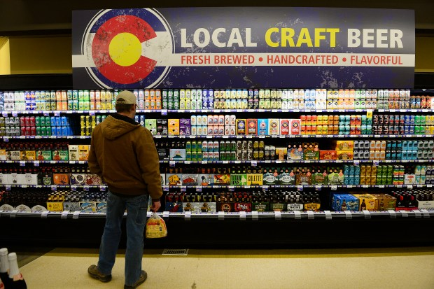 A customer shops for locally brewed ...
