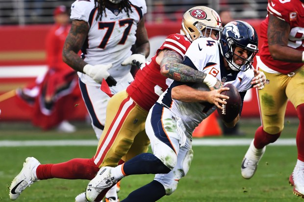Cassius Marsh (54) of the San Francisco 49ers sacks Case Keenum (4) of the Denver Broncos at Levi's Stadium on Dec. 9, 2018 in Santa Clara, Calif.