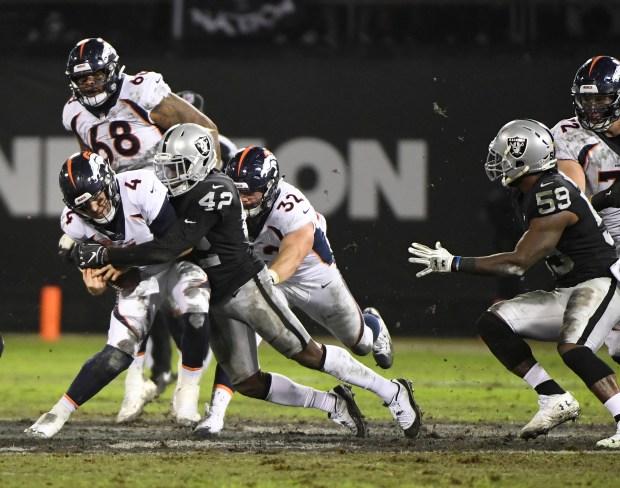 Denver Broncos quarterback Case Keenum (4) ...
