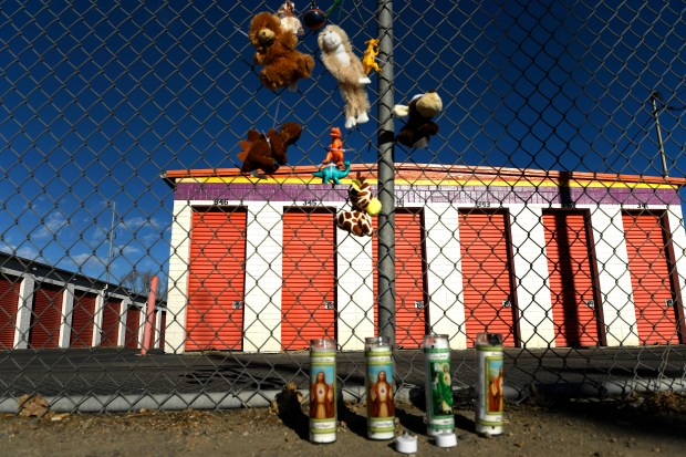 A makeshift memorial decorates the fence ...