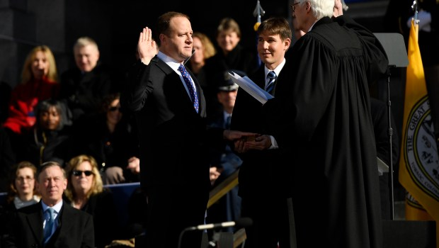 Governor-elect Jared Polis is given the ...