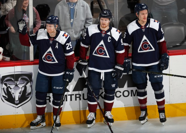 From left, Colorado Avalanche center Nathan ...