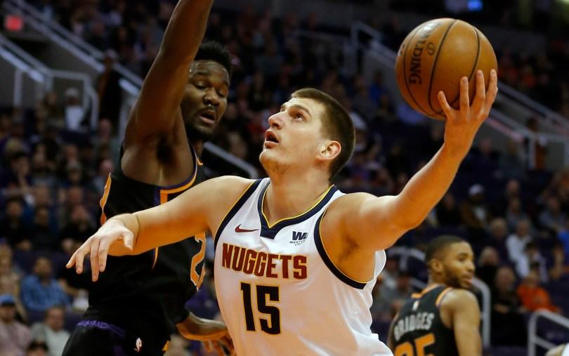 Denver Nuggets center Nikola Jokic (15) ...