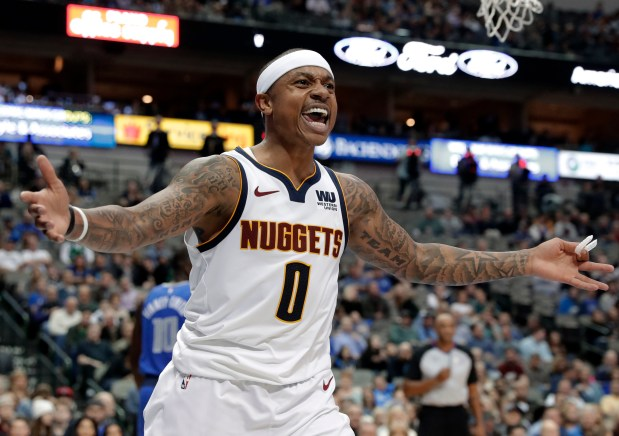 Denver Nuggets guard Isaiah Thomas shouts ...