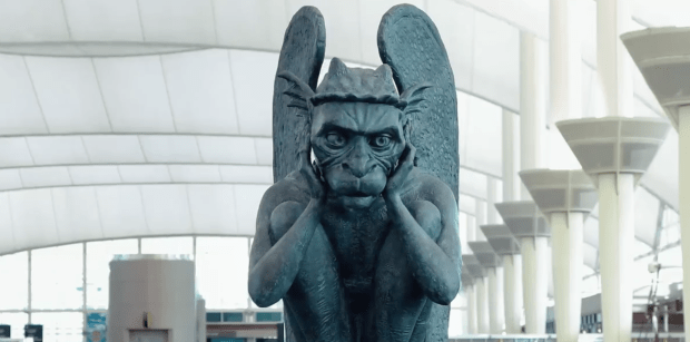 A screen grab from a Denver International Airport video showing the talking gargoyle startling passengers at the airport. The latest addition helps celebrate the airport's 24th birthday on Feb. 28, 2019.