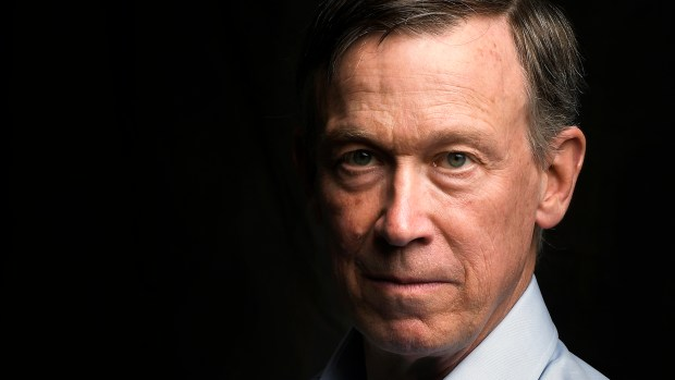 Former Colorado Governor John Hickenlooper poses ...