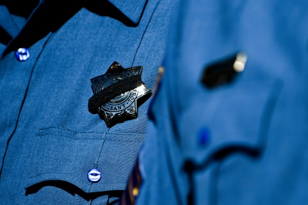 A Colorado State Patrol officer wears ...