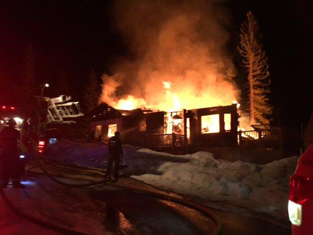 A house on fire after an explosion near Grand Lake. One person died and another was injured in the incident on March 24, 2019.