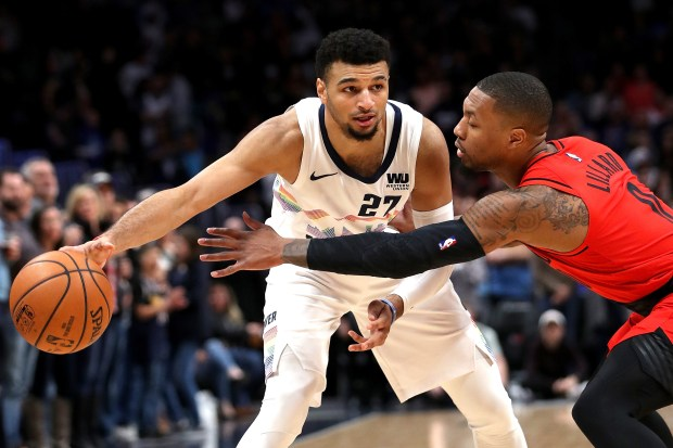 Jamal Murray (27) of the Denver Nuggets is guarded by Damian Lillard (0) the Portland Trail Blazers in the first quarter at the Pepsi Center on Jan. 13, 2019 in Denver.
