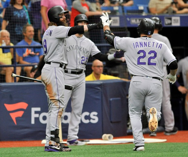 Colorado Rockies' Charlie Blackmon, left, and ...