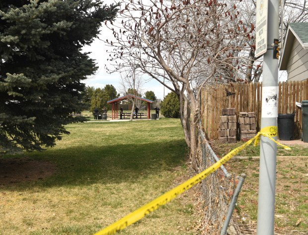 Police investigate a shooting in Norfolk Glen Park on April 9, 2019 in Aurora, Colorado.