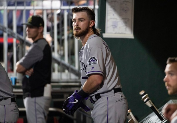 Colorado Rockies' Brendan Rodgers looks on ...