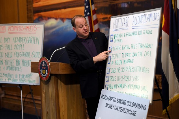 Governor Jared Polis speaks during a ...