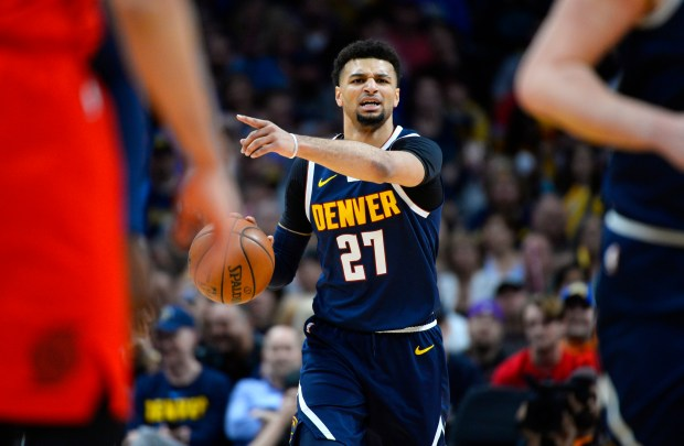 Denver Nuggets guard Jamal Murray directs ...