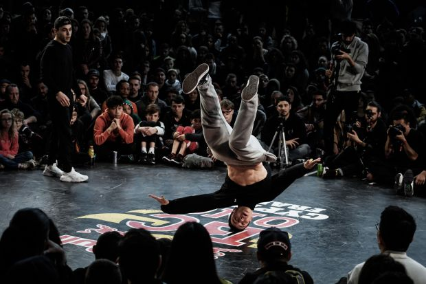A breakdance competitor performs during the ...