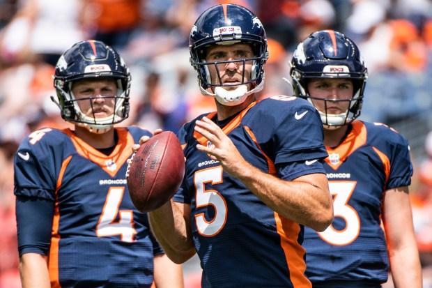 Denver Broncos quarterback Joe Flacco (5) ...