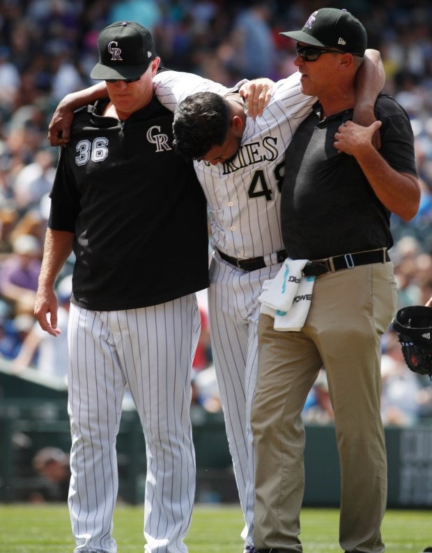 Colorado Rockies pitching coach Steve Foster, ...