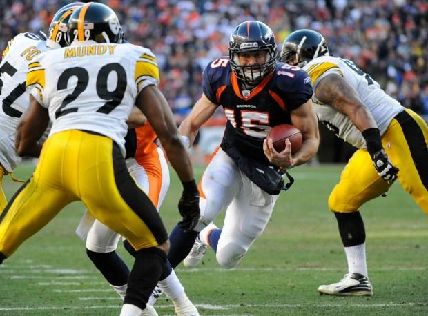 Denver Broncos quarterback Tim Tebow (15) ...
