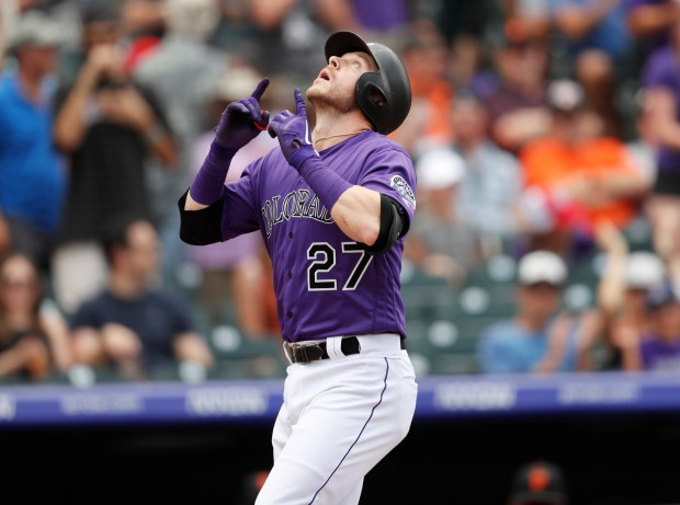 Colorado Rockies' Trevor Story gestures as ...