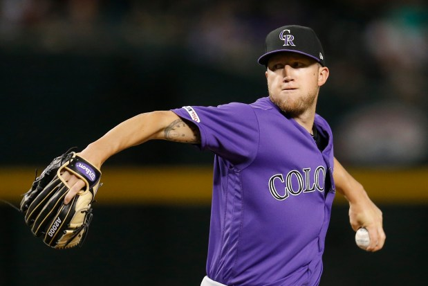 Colorado Rockies pitcher Kyle Freeland throws ...