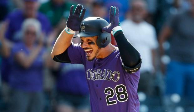Colorado Rockies' Nolan Arenado celebrates his ...