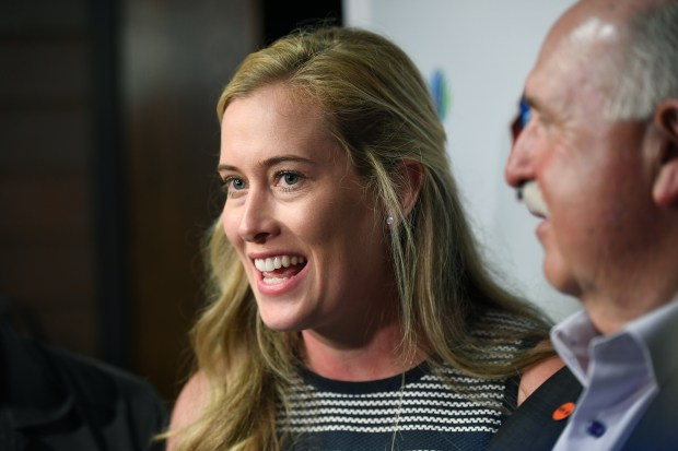 Brittany Bowlen talks with reporters during ...
