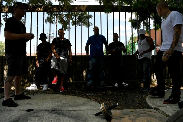 Residents hang out together outside during ...