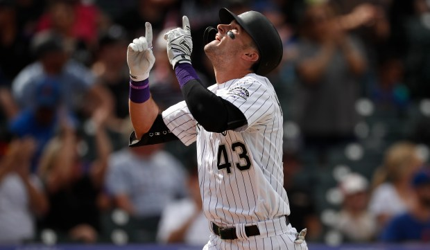 Colorado Rockies' Sam Hilliard gestures as ...