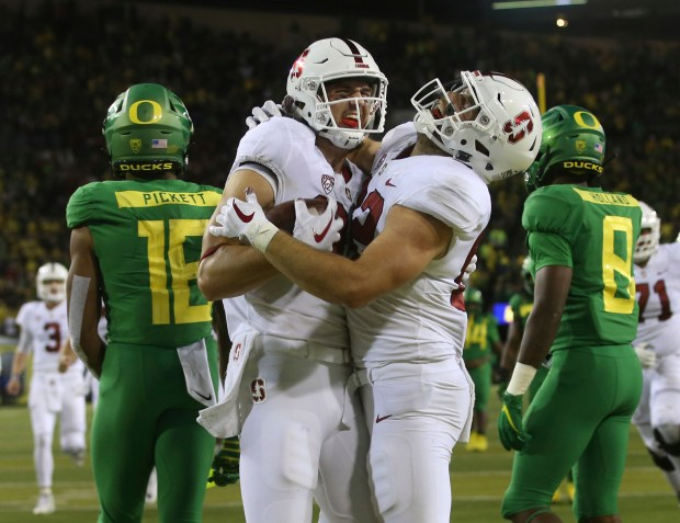 Stanford's Colby Parkinson, front left, and ...
