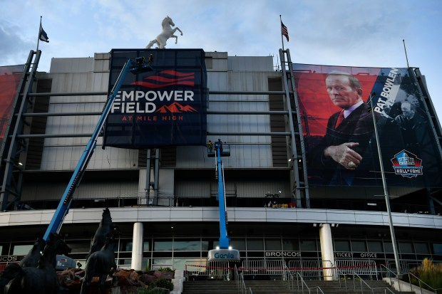 Crews install a new banner on ...