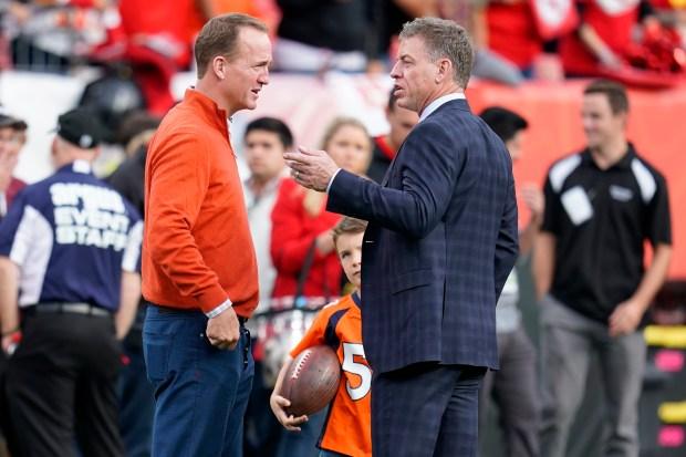 Former NFL quarterbacks Peyton Manning, left, ...