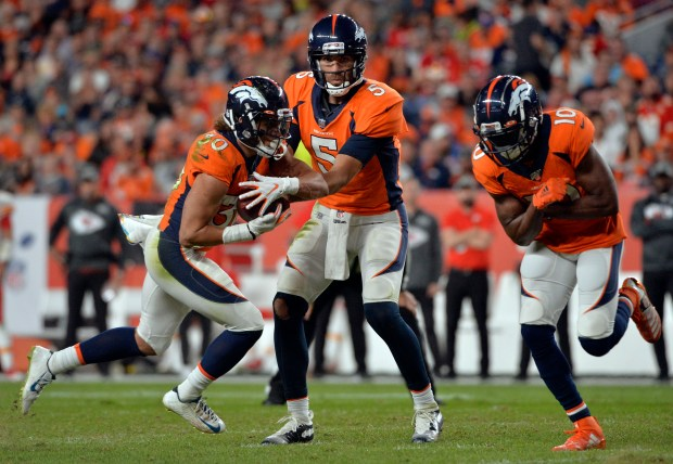 Denver Broncos quarterback Joe Flacco (5) ...